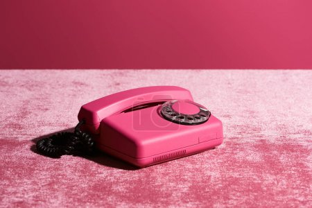 Photo for Vintage phone on velour pink cloth isolated on pink, girlish concept - Royalty Free Image