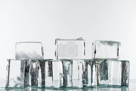 Photo for Melting transparent clear square ice cubes isolated on white - Royalty Free Image