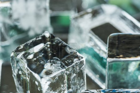 Photo for Close up view of melting transparent clear square ice cubes - Royalty Free Image