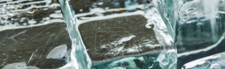 Photo for Close up view of melting transparent clear square ice cubes, panoramic shot - Royalty Free Image