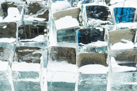close up view of melting transparent clear square ice cubes