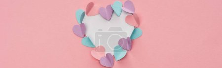 Photo pour Top view of colorful paper hearts as frame on pink background, panoramic shot - image libre de droit