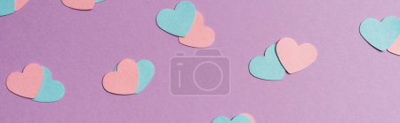 Photo for Seamless pattern of colorful paper hearts on violet background, panoramic shot - Royalty Free Image