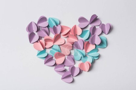 Photo for Top view of small paper hearts on white background - Royalty Free Image