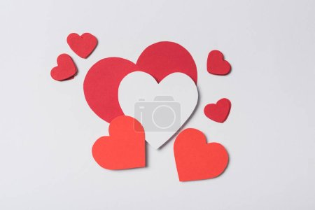 top view of red hearts on white background