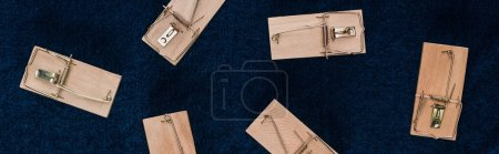 Photo for Top view of wooden mousetraps on blue background, panoramic shot - Royalty Free Image