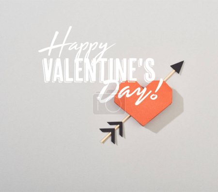 Photo for Top view of decorative paper heart with arrow on grey background with happy valentines day illustration - Royalty Free Image