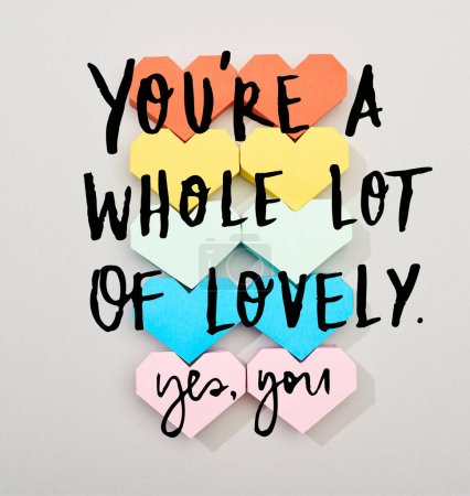 Photo for Top view of colorful heart shaped papers on grey background with you are a whole lot of lovely lettering - Royalty Free Image