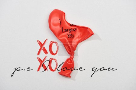 Top view of balloons with i forgive you lettering on grey background with xoxo, i love you lettering