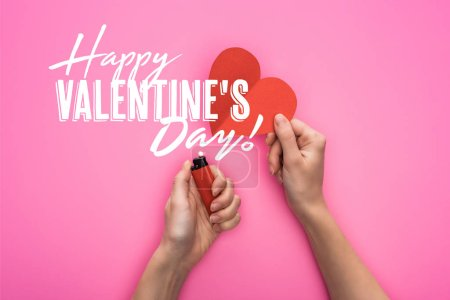 Photo for Cropped view of woman lighting up empty red paper heart with lighter isolated on pink with happy valentines day illustration - Royalty Free Image