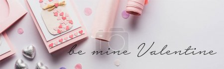 Photo for Top view of valentines decoration, greeting card, hearts and wrapping paper on white background with be mine valentine lettering, panoramic shot - Royalty Free Image