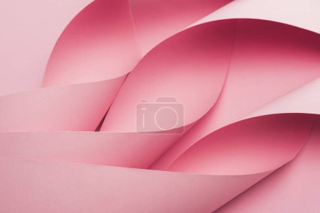 Photo pour Abstraction of pink paper swirls on pink background - image libre de droit
