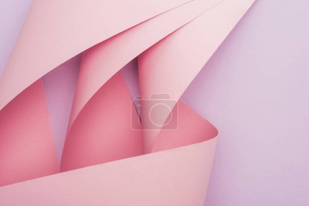Photo for Top view of pink paper swirls on violet background - Royalty Free Image