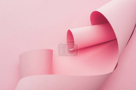 Photo for Abstract pink paper swirls on pink background - Royalty Free Image