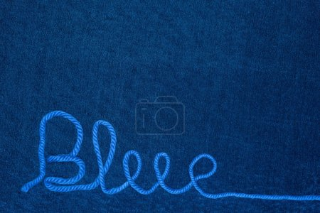 Photo for Top view of word blue from thread on blue cloth - Royalty Free Image