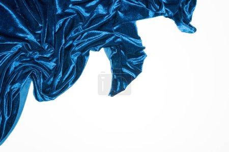 Photo pour Vue du dessus du tissu de velours bleu isolé sur blanc avec espace de copie - image libre de droit
