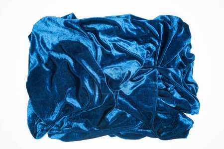 Photo for Top view of crumpled blue fabric isolated on white - Royalty Free Image