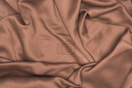 Photo pour Vue de fond du tissu satin brun ondulé - image libre de droit