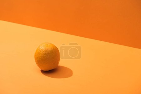 Photo for Fresh whole orange on orange background - Royalty Free Image
