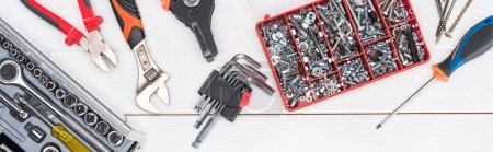 Photo for Top view of tools with tool boxes on white wooden surface, panoramic shot - Royalty Free Image