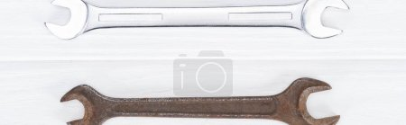 Photo for Top view of shiny and rustle on white wooden background, panoramic shot - Royalty Free Image