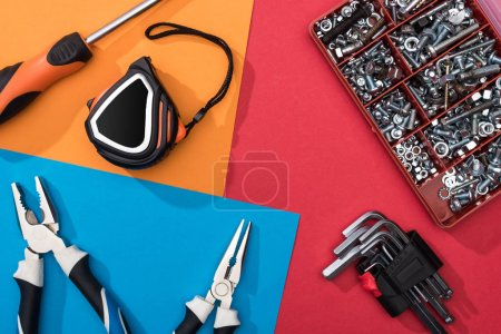 Photo for Top view of tool set with pliers and measuring tape on colorful background - Royalty Free Image