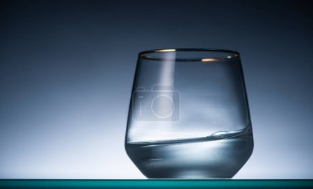 Photo for Transparent glass with vodka in dark with back light - Royalty Free Image