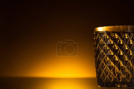 Photo for Faceted glass in dark with warm back light - Royalty Free Image