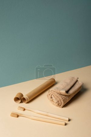 Foto de Toothbrushes, toothbrush case, towel on beige and grey, zero waste concept - Imagen libre de derechos