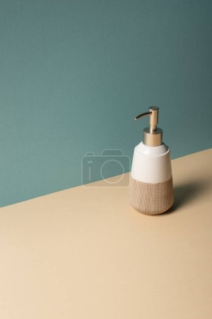 Photo for Liquid soap dispenser on beige and grey, zero waste concept - Royalty Free Image