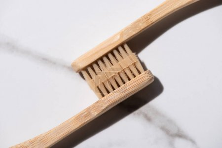 Top view of connected toothbrushes on white background, zero waste concept