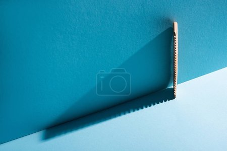Photo for Wooden comb on blue background, zero waste concept - Royalty Free Image
