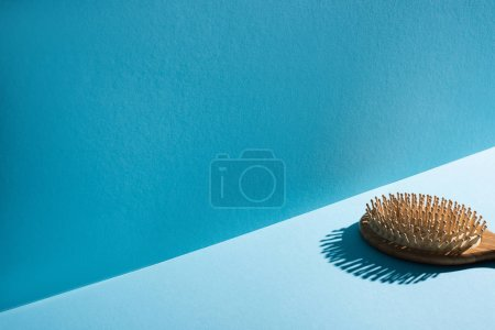 Photo for Wooden hair brush on surface on blue background, zero waste concept - Royalty Free Image