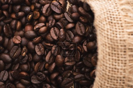 Photo for Selective focus of fresh roasted coffee beans in sack - Royalty Free Image