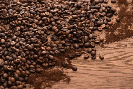 Photo for Fresh roasted coffee beans and ground coffee on wooden table - Royalty Free Image