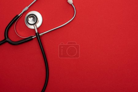 Photo for Top view of stethoscope isolated on red - Royalty Free Image