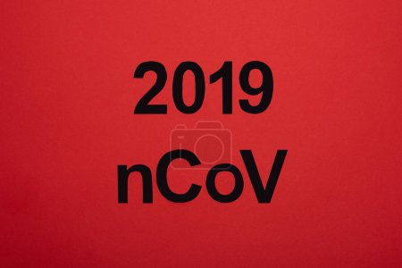 Top view of 2019 ncov lettering isolated on red