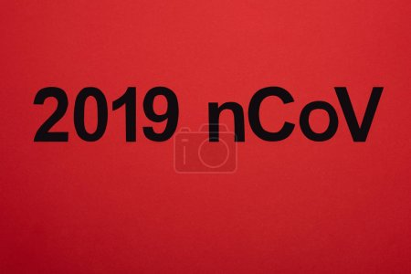 Top view of 2019 ncov black lettering isolated on red