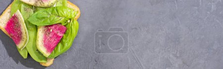 Photo for Panoramic shot of sandwich with green peas and radish on stone table - Royalty Free Image