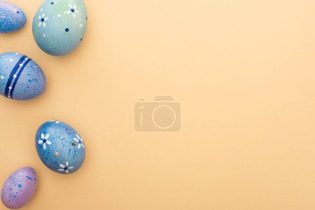 Photo for Top view of purple quail and chicken eggs on beige background - Royalty Free Image