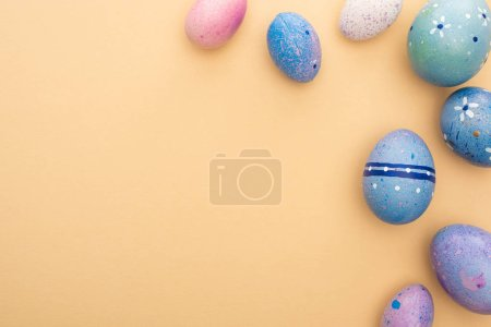 Top view of Easter eggs on beige background