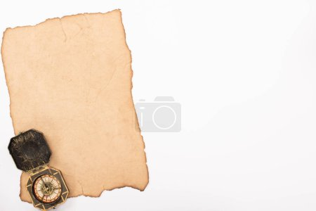 Photo for Top view of vintage compass on aged paper isolated on white - Royalty Free Image