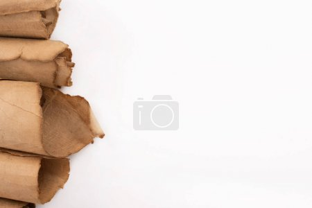 Photo pour Top view of vintage rolled aged paper isolated on white - image libre de droit
