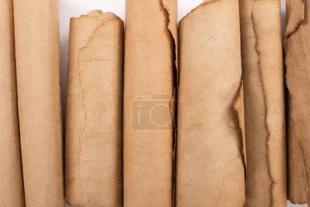Photo pour Top view of vintage rolled aged paper on white - image libre de droit
