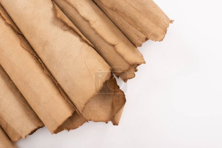 Photo for Top view of vintage rolled aged paper isolated on white - Royalty Free Image