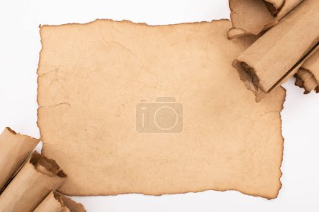 Photo for Top view of vintage blank and rolled paper isolated on white - Royalty Free Image