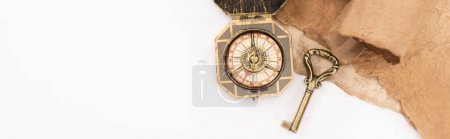 Photo for Top view of vintage key, compass and aged paper isolated on white, panoramic shot - Royalty Free Image