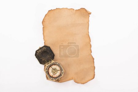 Photo for Top view of vintage compass on aged empty paper isolated on white - Royalty Free Image