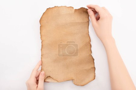 Photo for Cropped view of woman holding empty aged paper isolated on white - Royalty Free Image