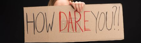 Photo for Panoramic view of woman holding placard with how dare you lettering isolated on black, global warming concept - Royalty Free Image